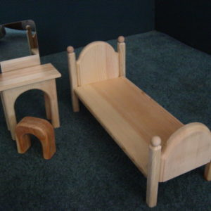 Bedroom set comes unfinished and includes 3 pieces - bed, dressing table and chair.