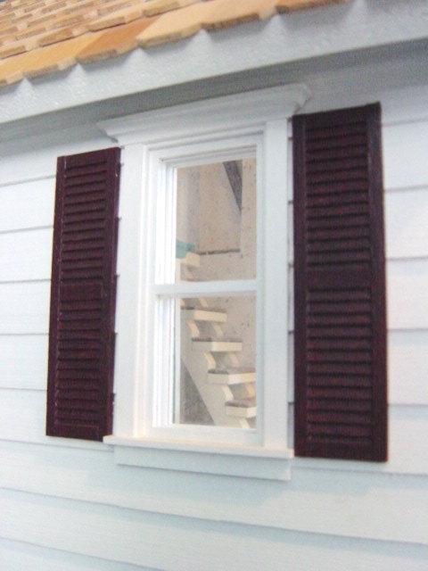 Finished exterior window, shutters & siding