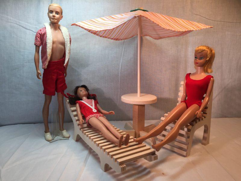GI Joe creator. Barbie Ken Scooter sitting on patio furniture while GI Joe on moon.